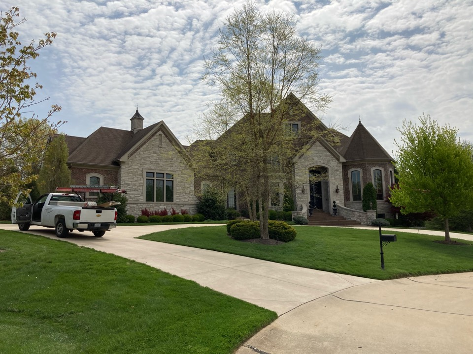 Chesterfield, MO - EBS is working with this homeowner to install a new architectural shingle roof plus an EPDM membrane roof on the rear patio.