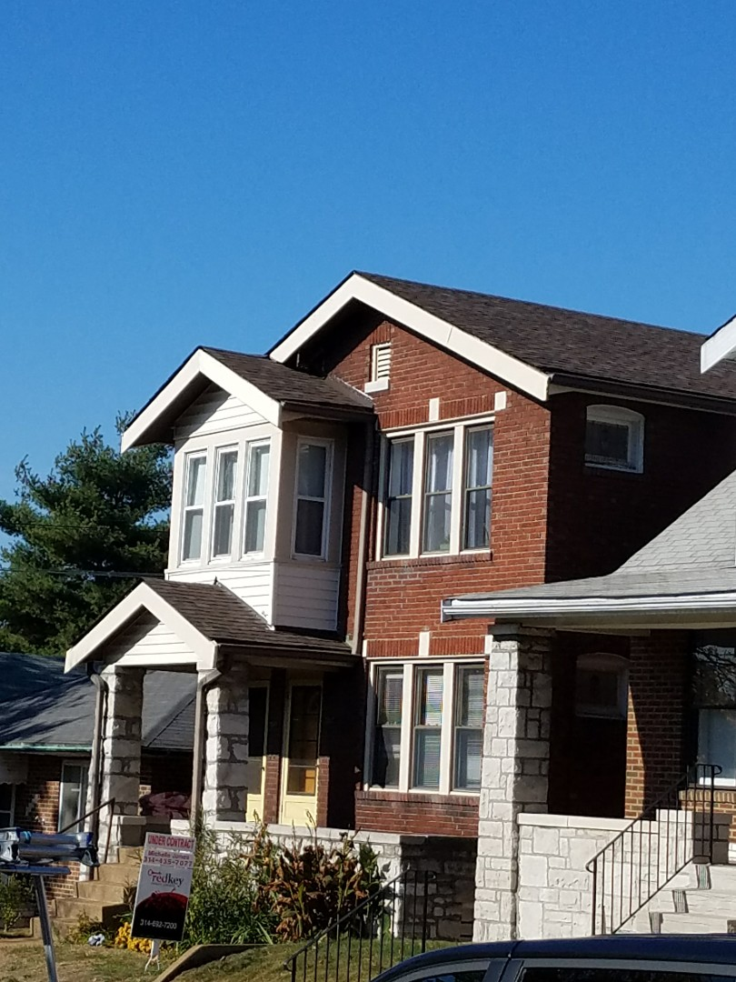 St. Louis, MO - EBS just finished a roof replacement project. Removed Clay Tiles and installed Architectural Shingles.