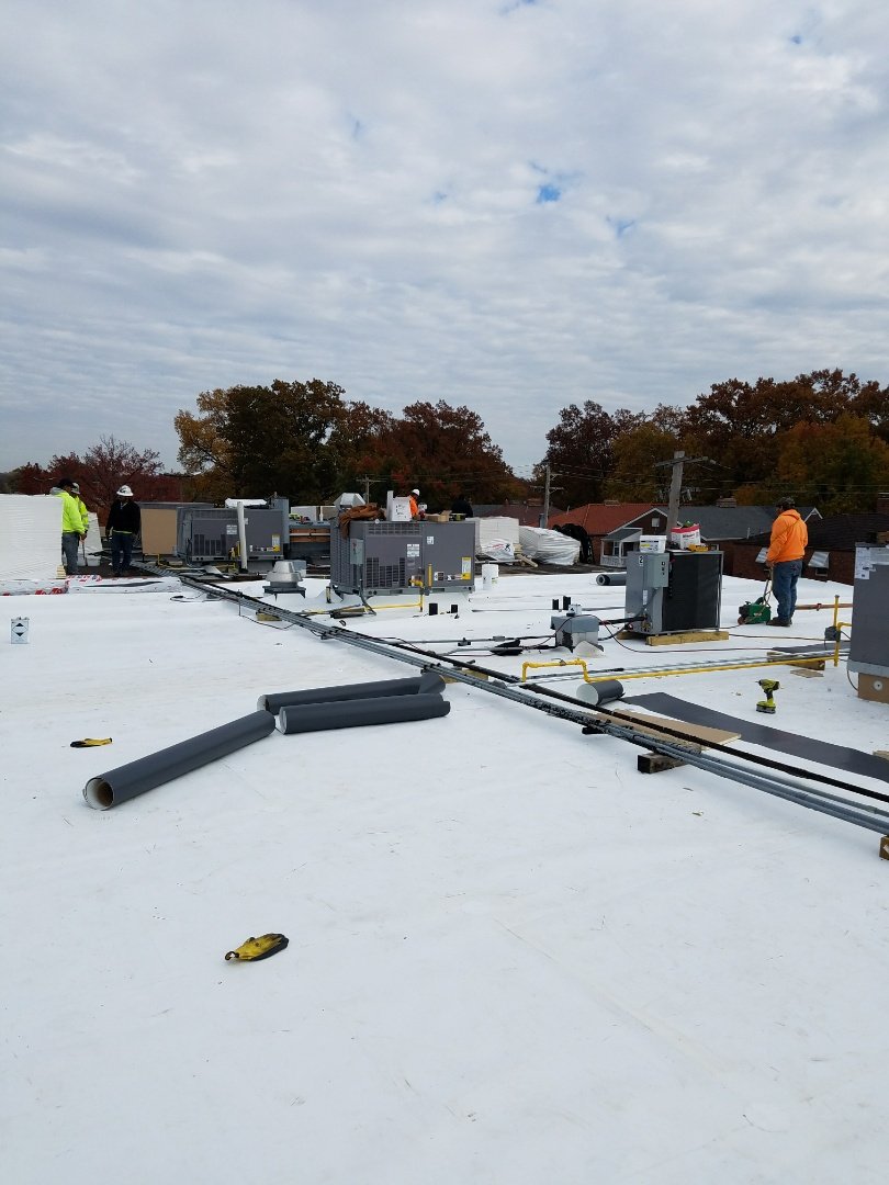 St. Louis, MO - EBS is busy installing a 60 mil GAF TPO roof system on a two story commercial Building. This project is 100 SQ in size.