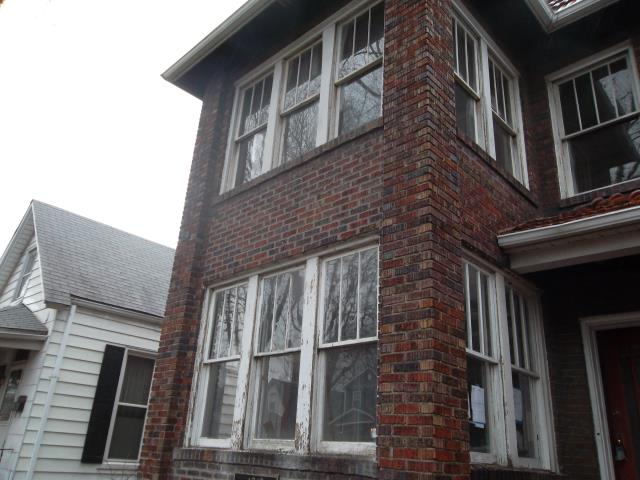 St. Louis, MO - Pricing to wrap window frames in aluminum to improve appearance and make maintenance free.