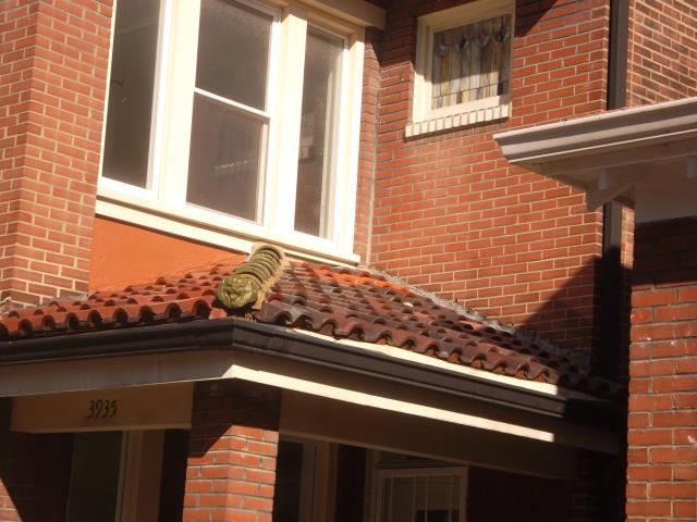St. Louis, MO - Pricing to replace the tiled roof with shingles to make potential buyers happy.