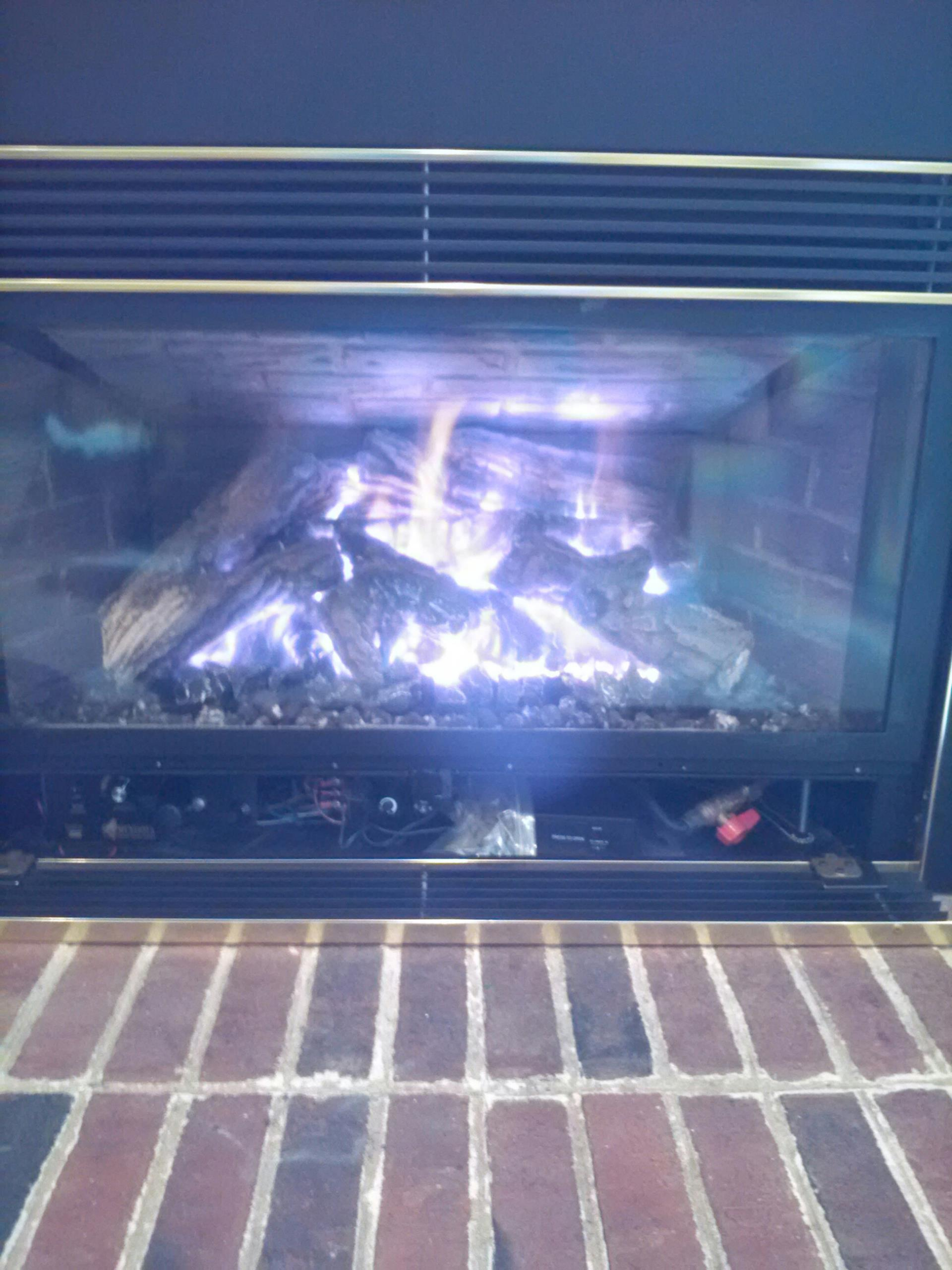 Crofton, MD - Gas fireplace insert & gas logs installation repair service call in Crofton Maryland.