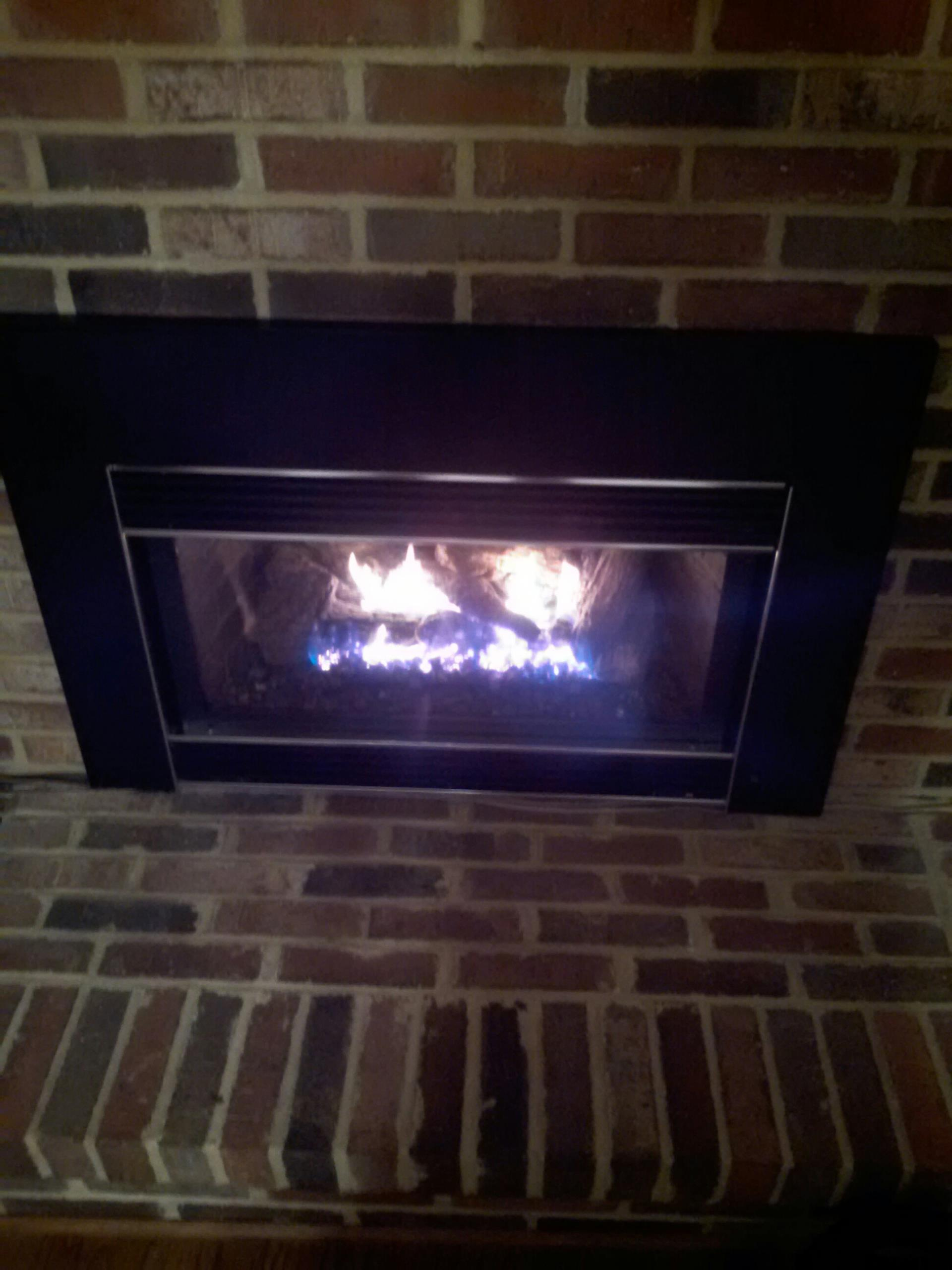 Gambrills, MD - Gas fireplace insert & gas logs installation repair service call in Gambrills Maryland.