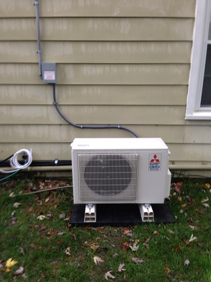 Crofton, MD - Mitsubishi heat pump heating AC system mini split installation repair service call in Crofton Maryland.