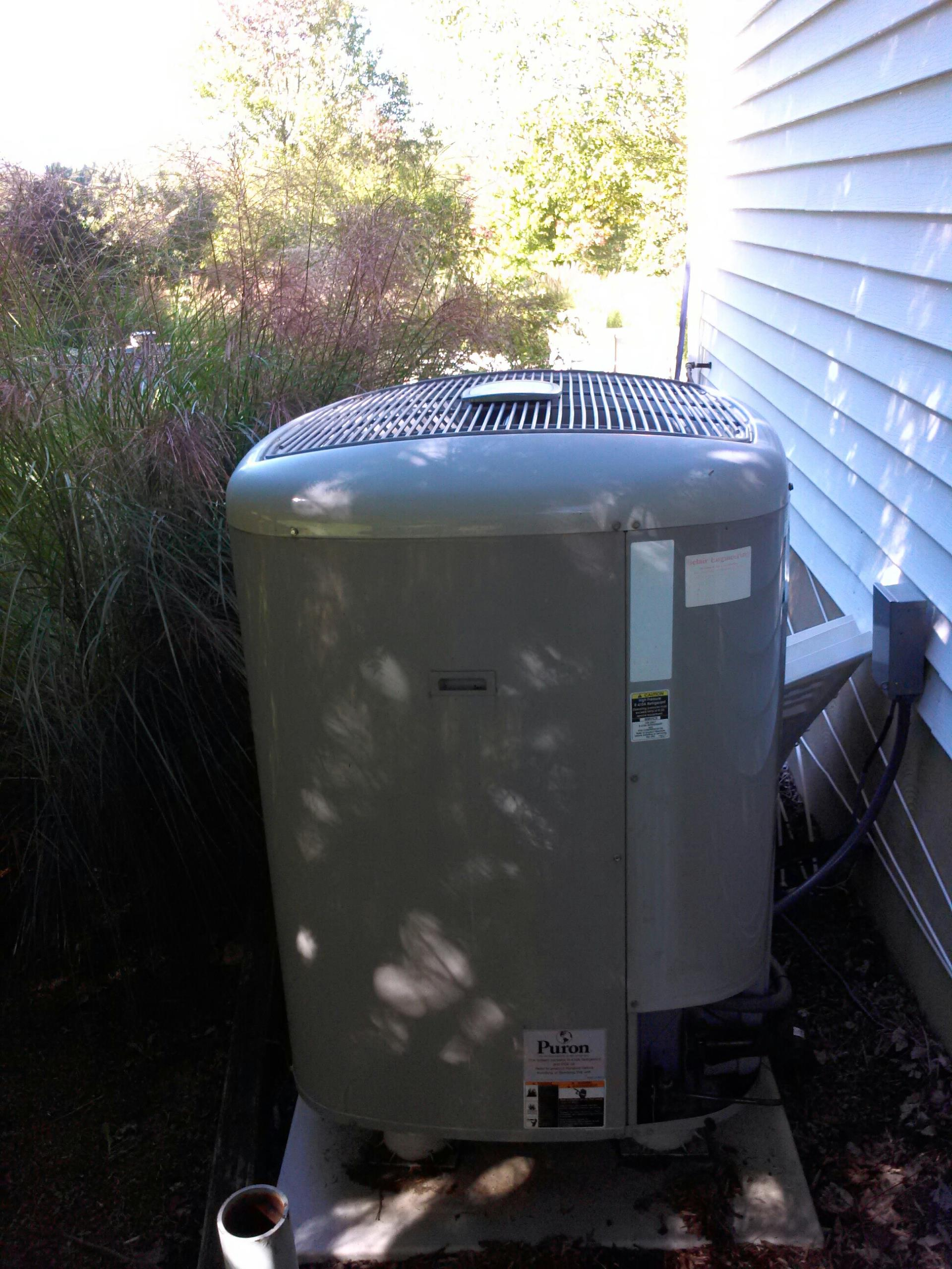 Gambrills, MD - Carrier heat pump electric furnace heating system & Aprilaire whole house humidifier installation repair service call in Gambrills Maryland 21054