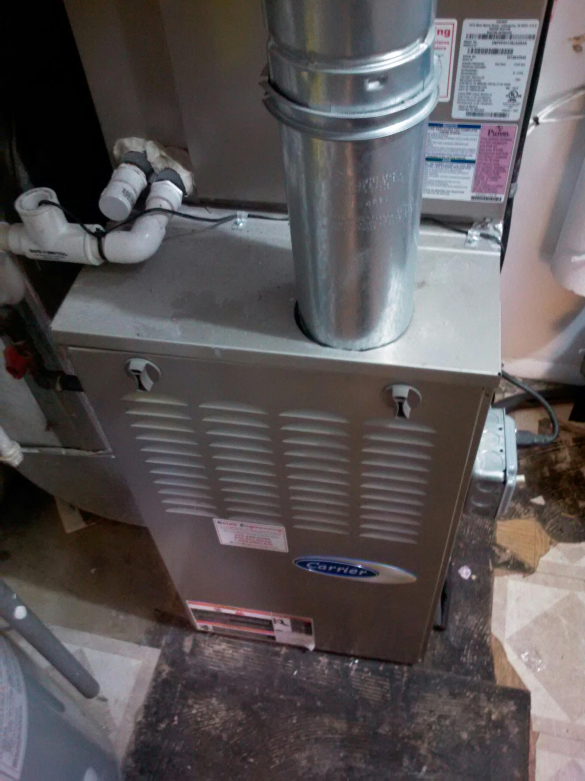 Crofton, MD - Carrier gas furnace heating & AC system replacement installation service call in Crofton Maryland 21114