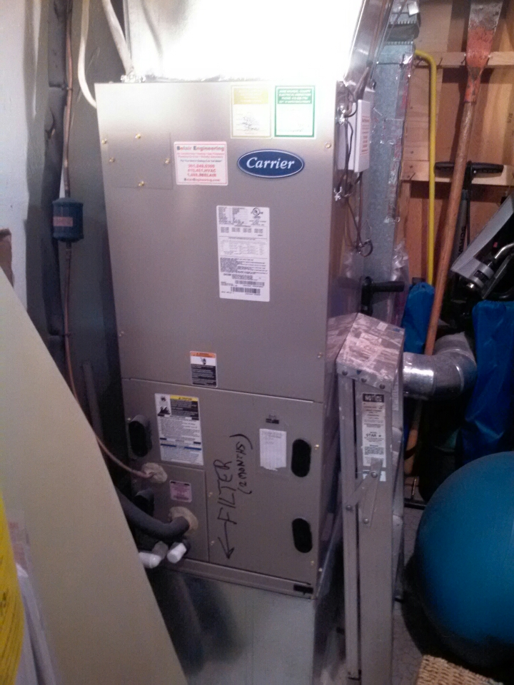 Crofton, MD - Carrier heat pump furnace heating & AC system, humidifier & electronic air cleaner installation repair service call in Crofton Maryland 21114