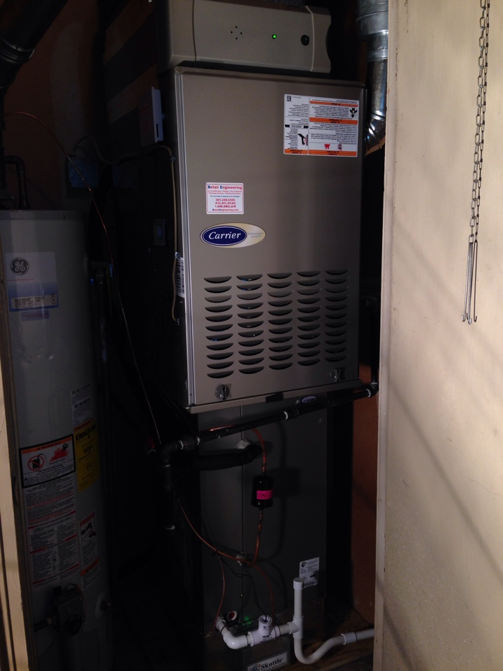 Crofton, MD - Carrier gas furnace heating & AC system & GE gas hot water heater replacement installation & plumbing repair service call in Crofton Maryland 21114