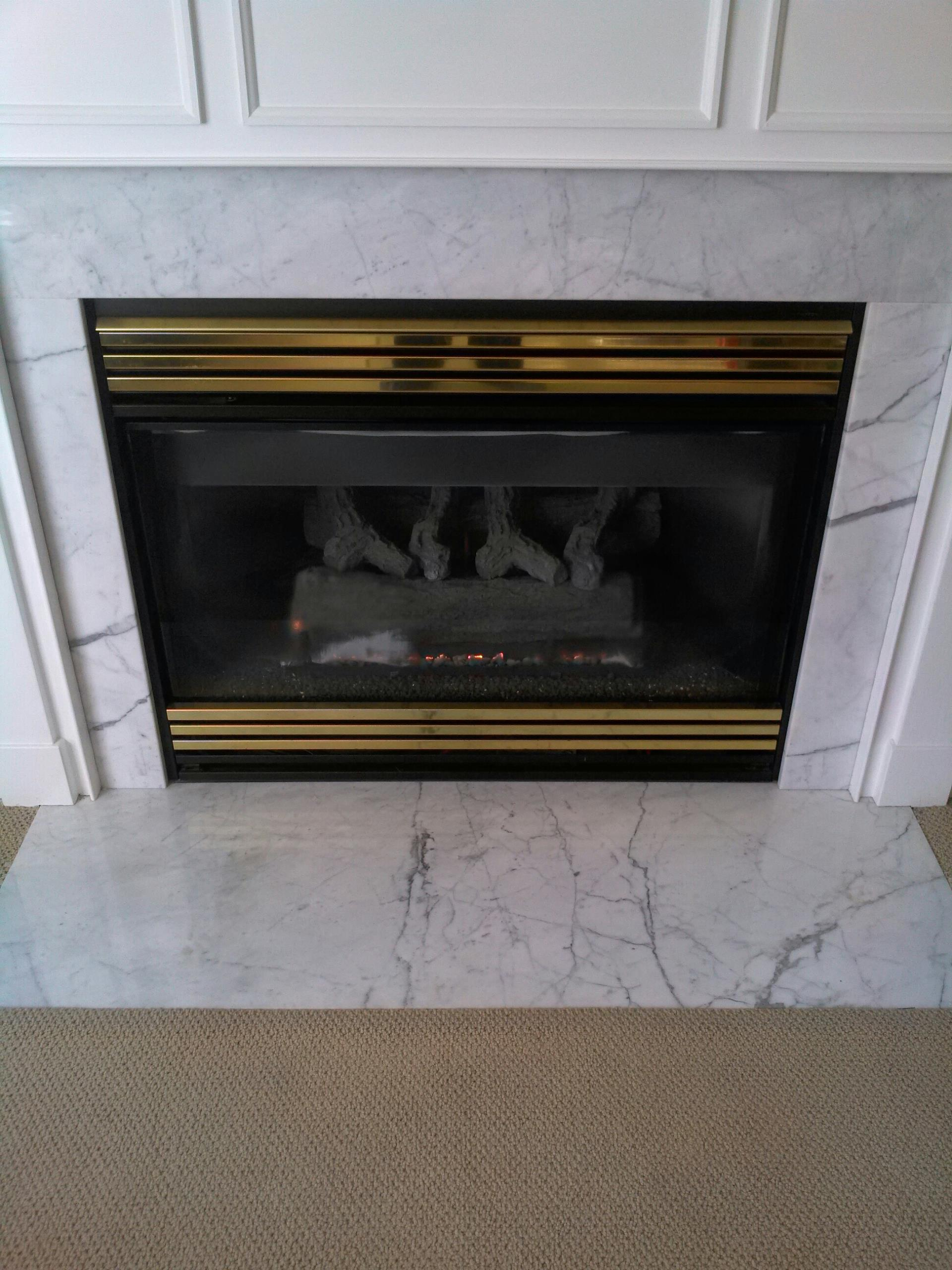 Gambrills, MD - Heat N Glo gas fireplace insert & gas logs installation repair service call in Gambrills Maryland 21054.
