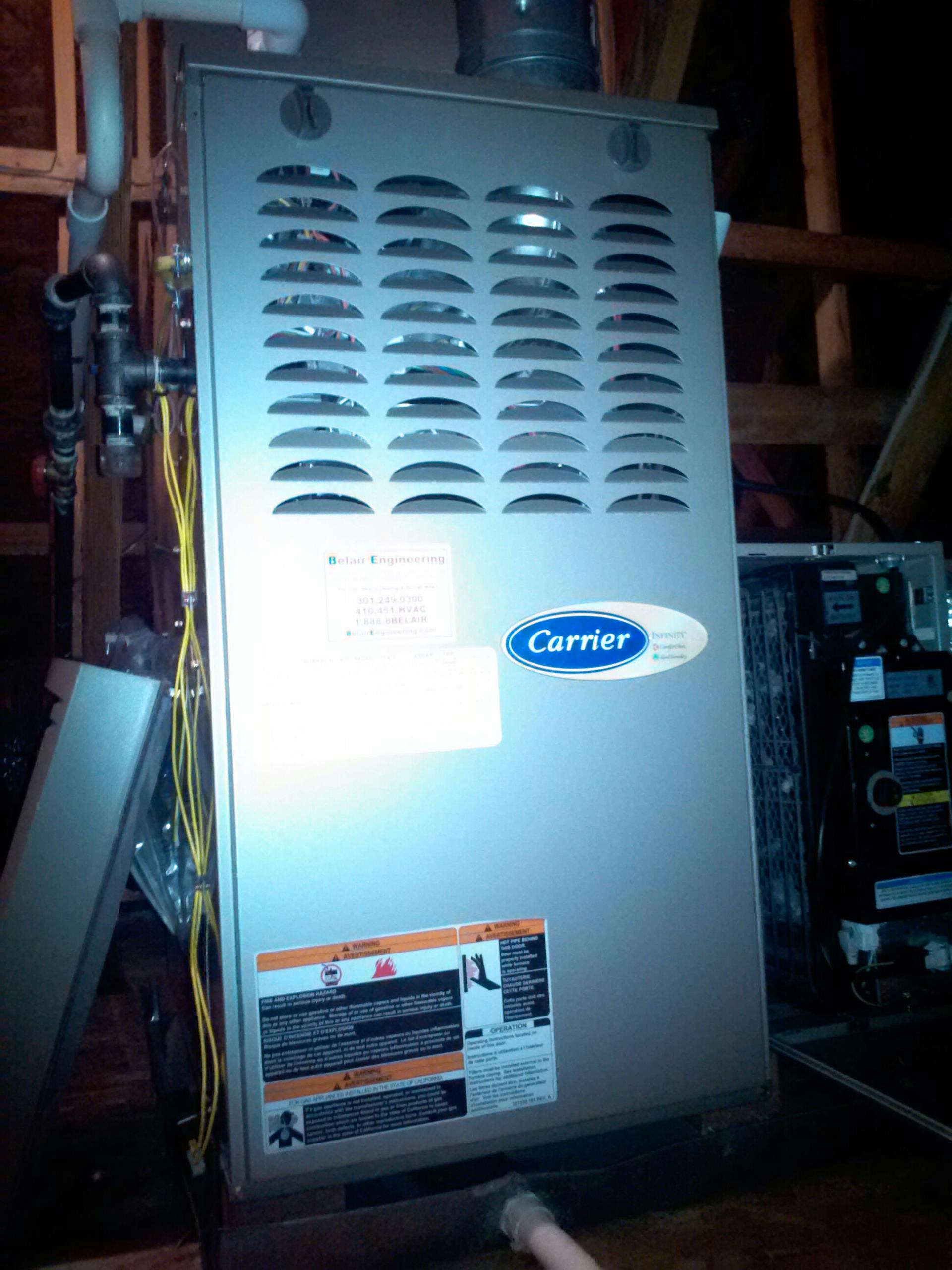 Crownsville, MD - Carrier gas furnace heating & AC system & whole house humidifier replacement installation service call in Crownsville Maryland 21032