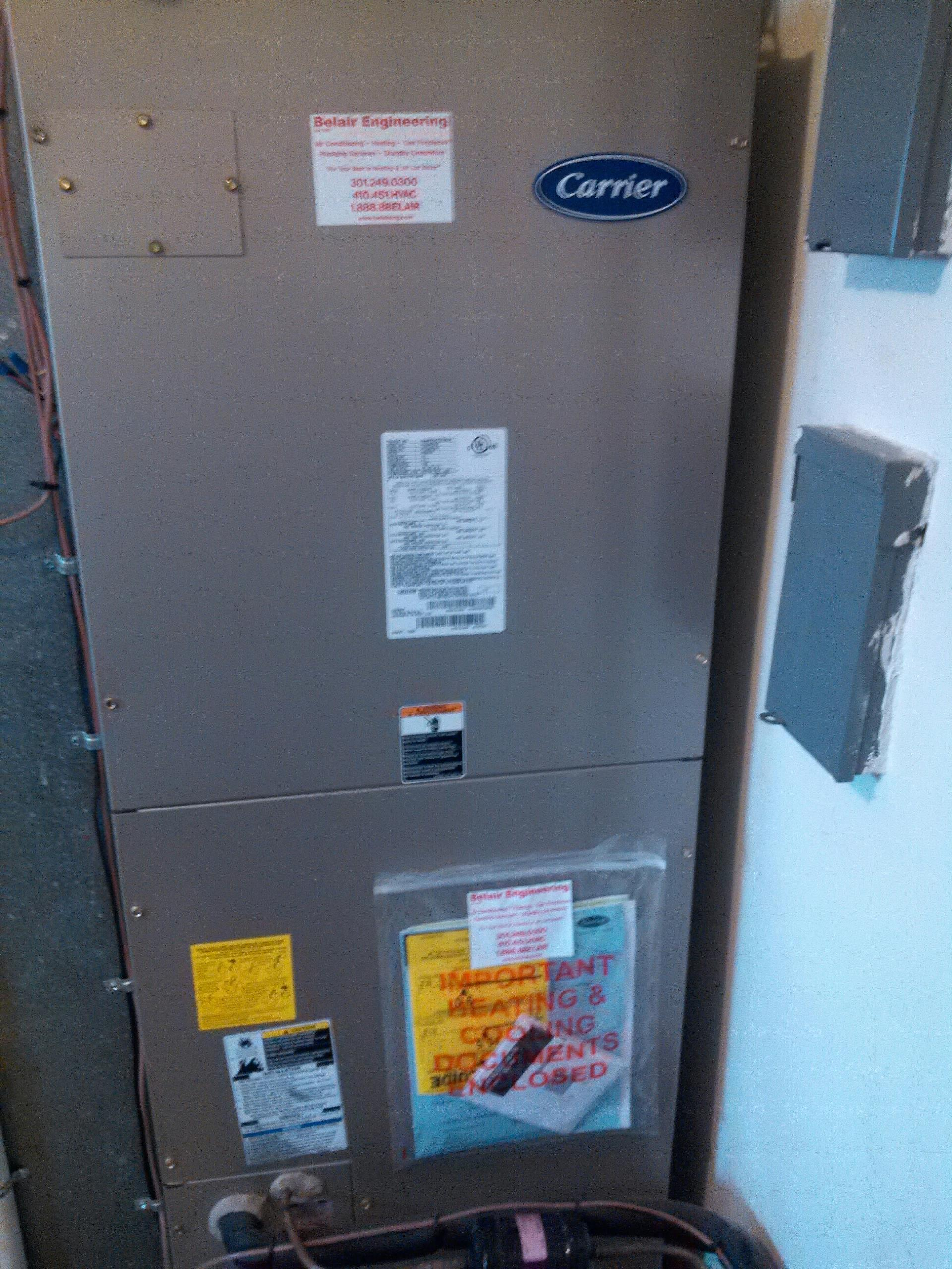 Gambrills, MD - Carrier heat pump furnace heating & AC system, State electric water heater replacement installation & plumbing repair service call in Gambrills Maryland 21054.