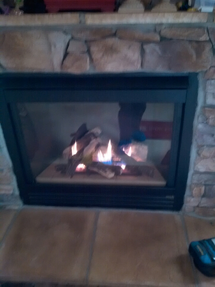 Gambrills, MD - Heat N Glo gas fireplace insert & gas logs installation repair service call in Gambrills Maryland 21054