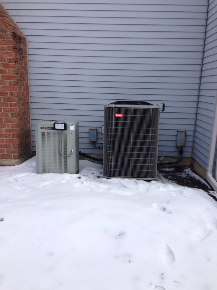 Gambrills, MD - Trane heat pump furnace heating & air conditioning system, Ruud water heater & Aprilaire humidifier replacement installation & plumbing repair service call in Gambrills Maryland 21054