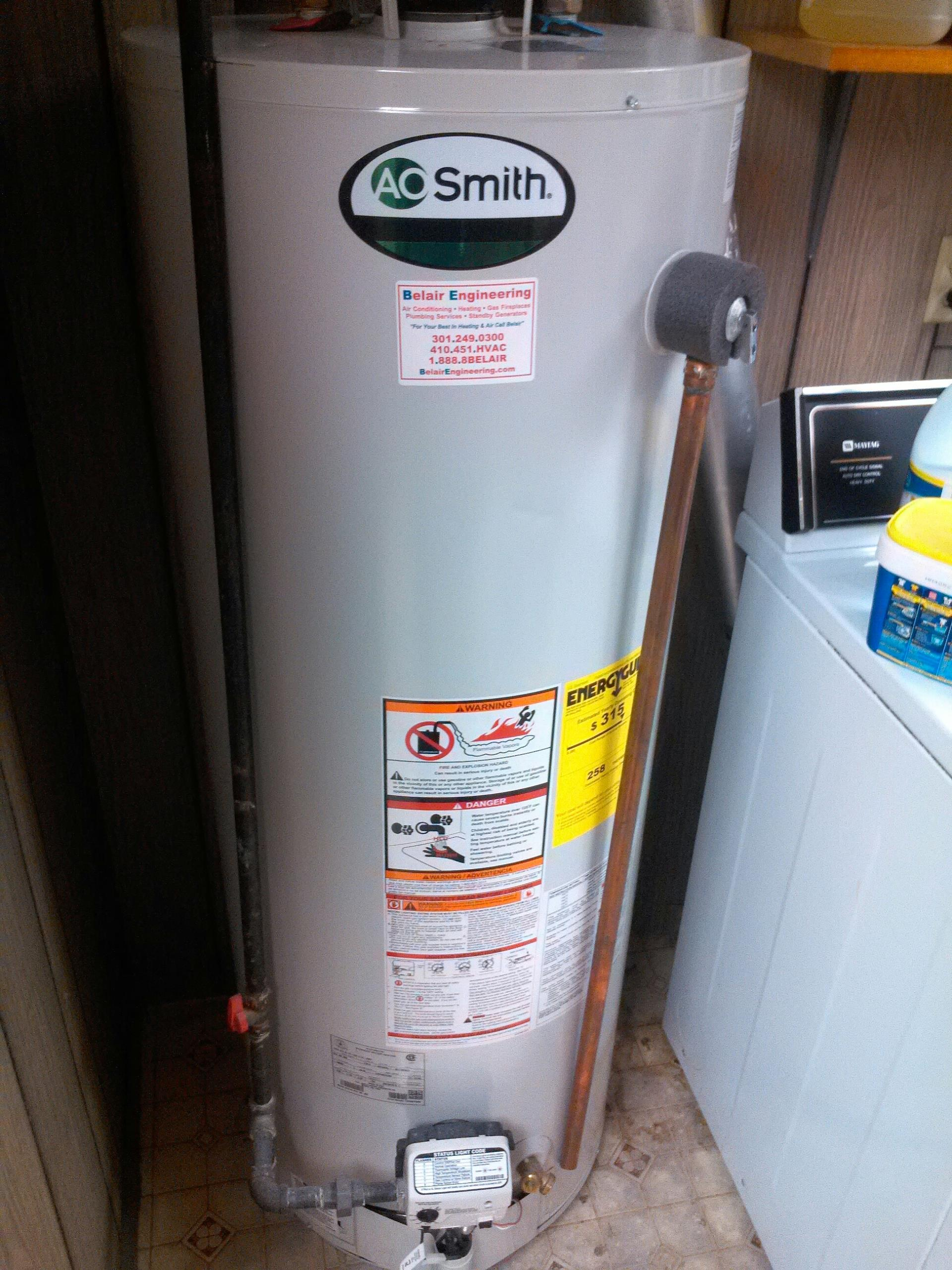 Crofton, MD - Carrier gas furnace heater & cooling HVAC system, gas hot water heater, Skuttle furnace humidifier & Infinity electronic air cleaner replacement installation repair service call in Crofton Maryland 21114