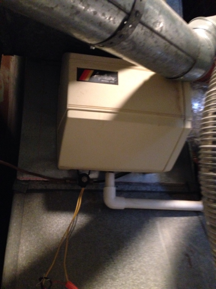 Morningside, MD - Carrier gas furnace heating & AC system, Whirlpool water heater, Aprilaire humidifier & Honeywell electronic air cleaner replacement installation & plumbing repair service call in Morningside Maryland 20746