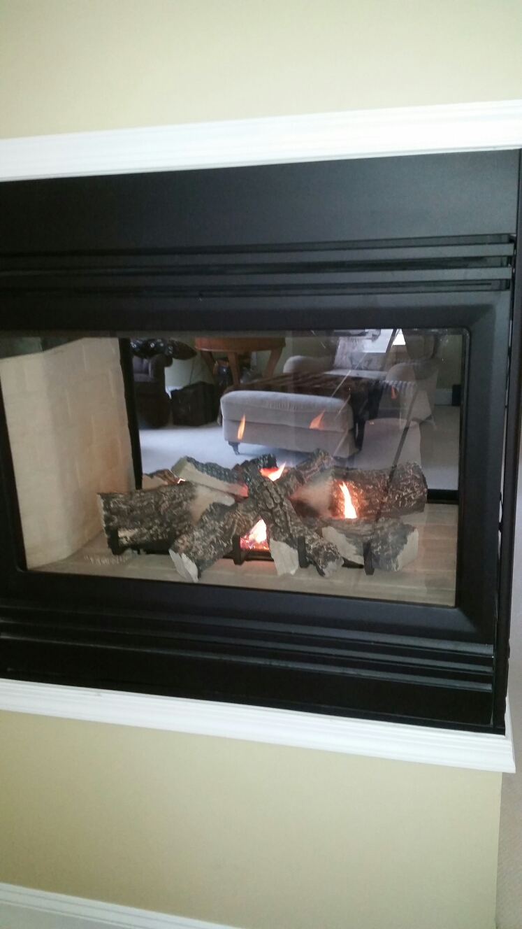 Crownsville, MD - Heat n glo gas fireplace insert & gas logs installation repair service call in Crownsville Maryland 21032