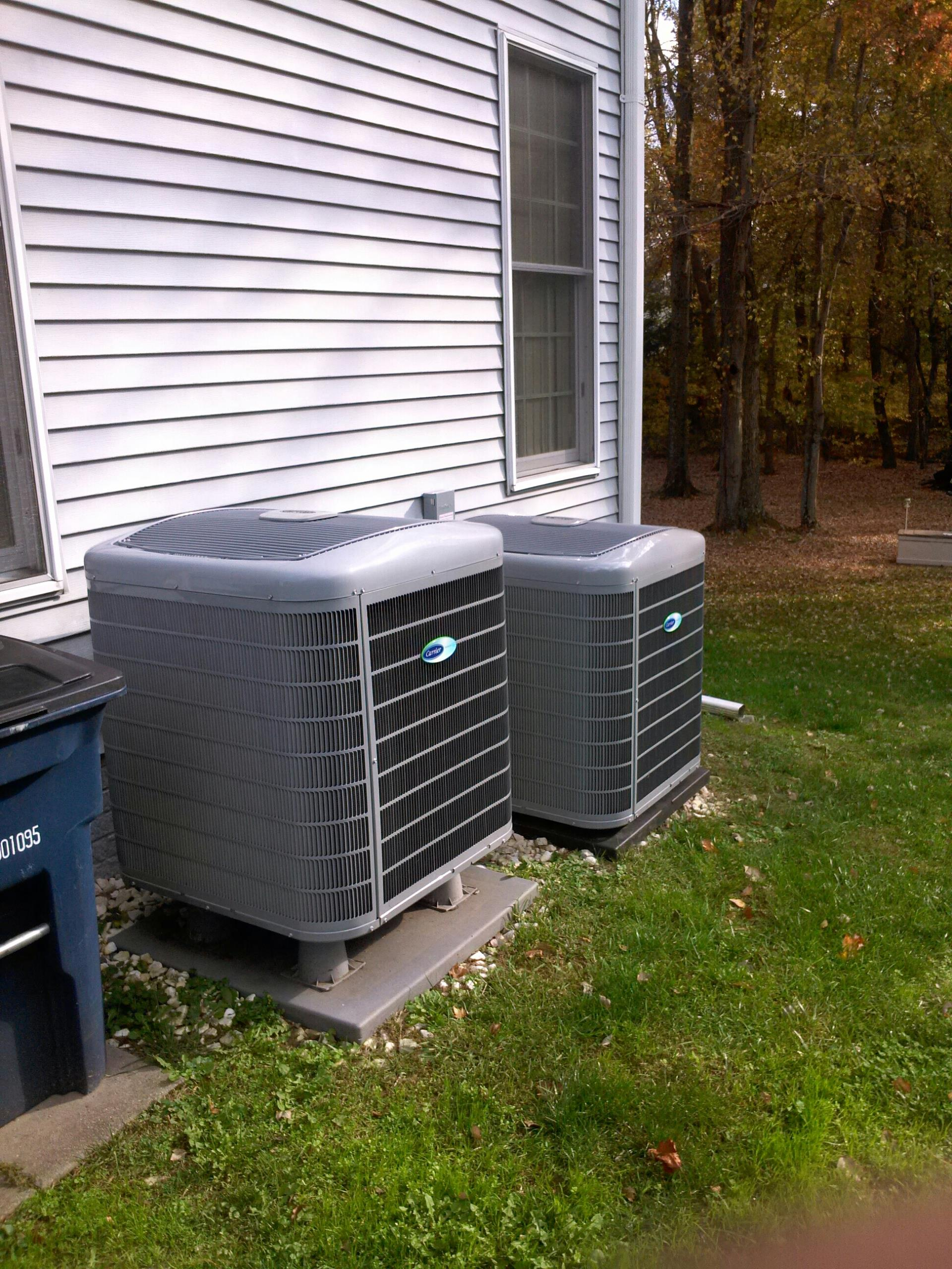 Crownsville, MD - Carrier heat pump AC air conditioning & heating system installation repair service call in Crownsville Maryland 21032