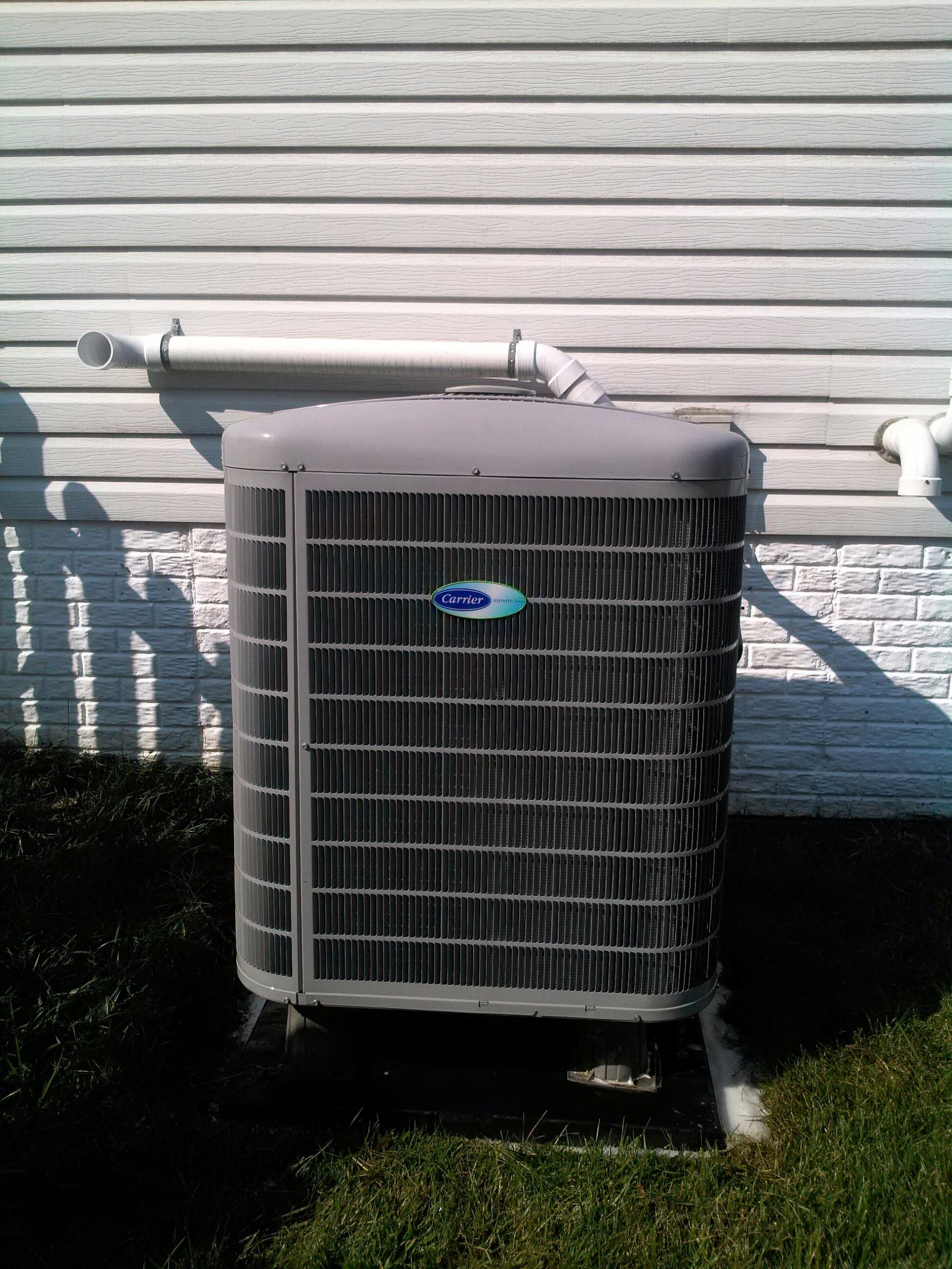 Gambrills, MD - Carrier heat pump heating & air conditioning system replacement installation repair service call Gambrills Maryland 21054