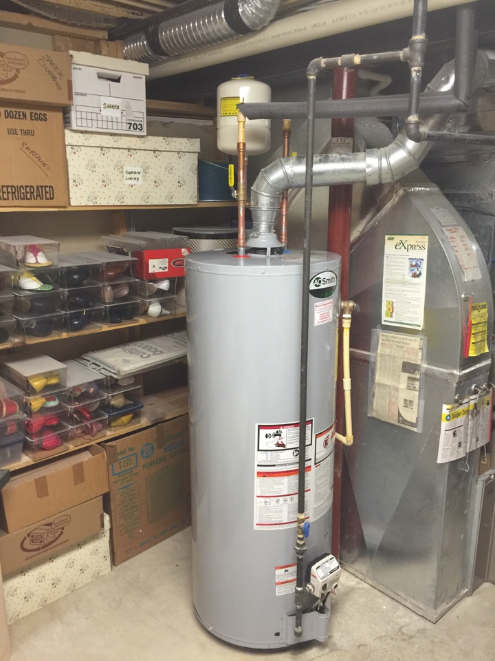 Crofton, MD - Rheem gas hot water heater replacement installation & plumbing repair service call Crofton Maryland