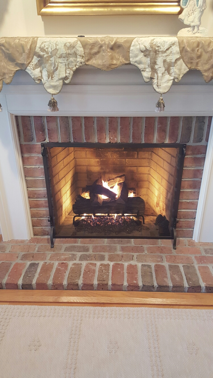 Crownsville, MD - Peterson gas fireplace insert & gas logs installation repair service call Crownsville Maryland