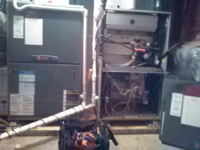 Crownsville, MD - Trane gas furnace heating & air conditioning system air filter & humidifier pad replacement installation maintenance repair service call Crownsville Maryland