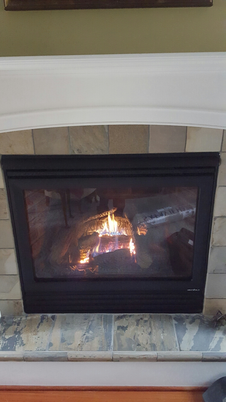 Crownsville, MD - Heat n glo gas fireplace insert & gas logs installation repair service call Crownsville Maryland