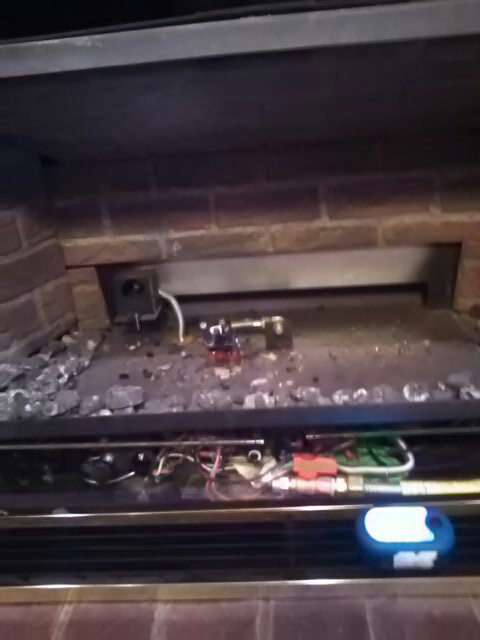 Glenarden, MD - Gas fireplace insert installation repair service call.