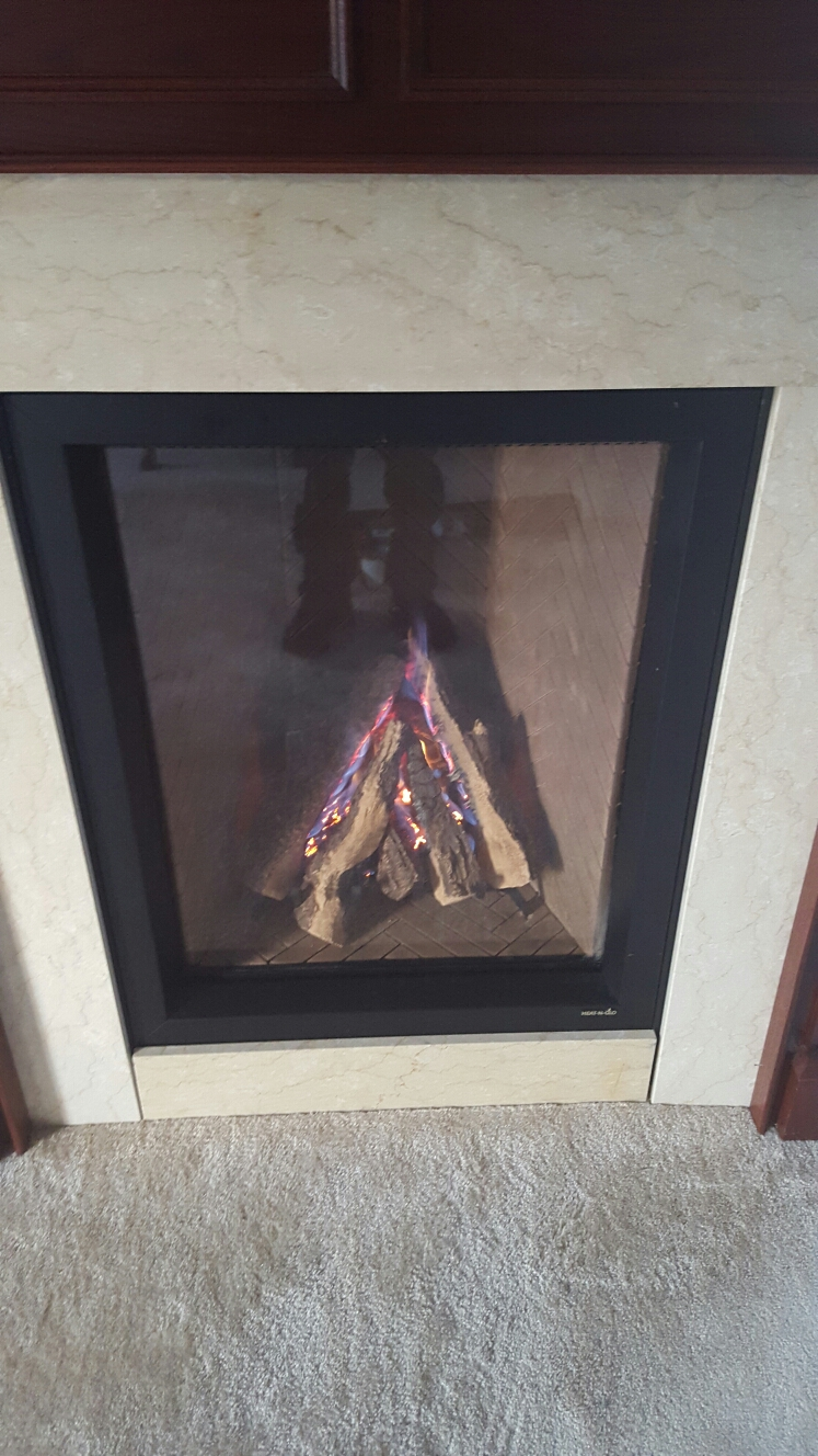 Gambrills, MD - Heat N Glo gas fireplace insert & gas logs pilot assembly & gas valve replacement installation repair service call Gambrills Maryland