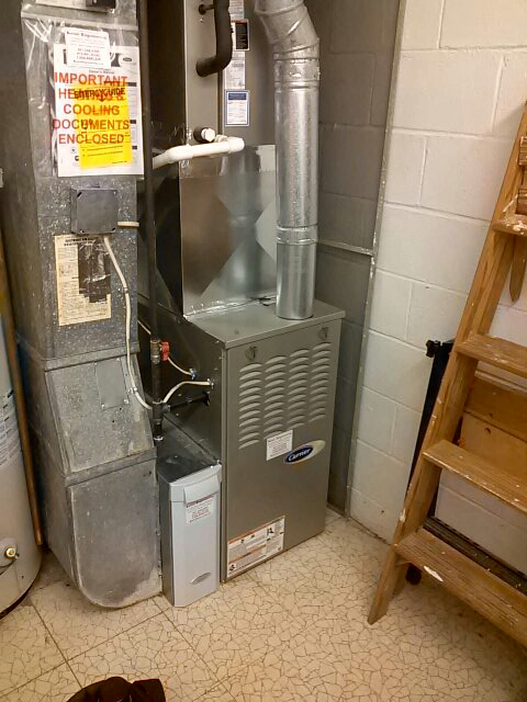 Crofton, MD - Carrier gas furnace heating & air conditioning system air filter replacement installation repair service call Crofton Maryland
