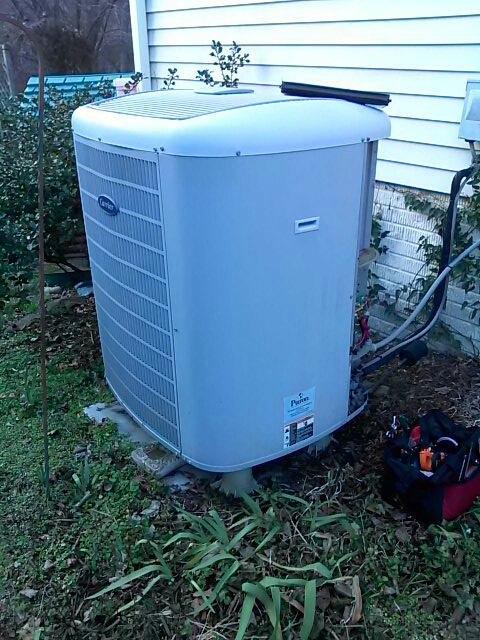Crofton, MD - Carrier heat pump heating & air conditioning system furnace filter replacement installation repair service call Crofton Maryland
