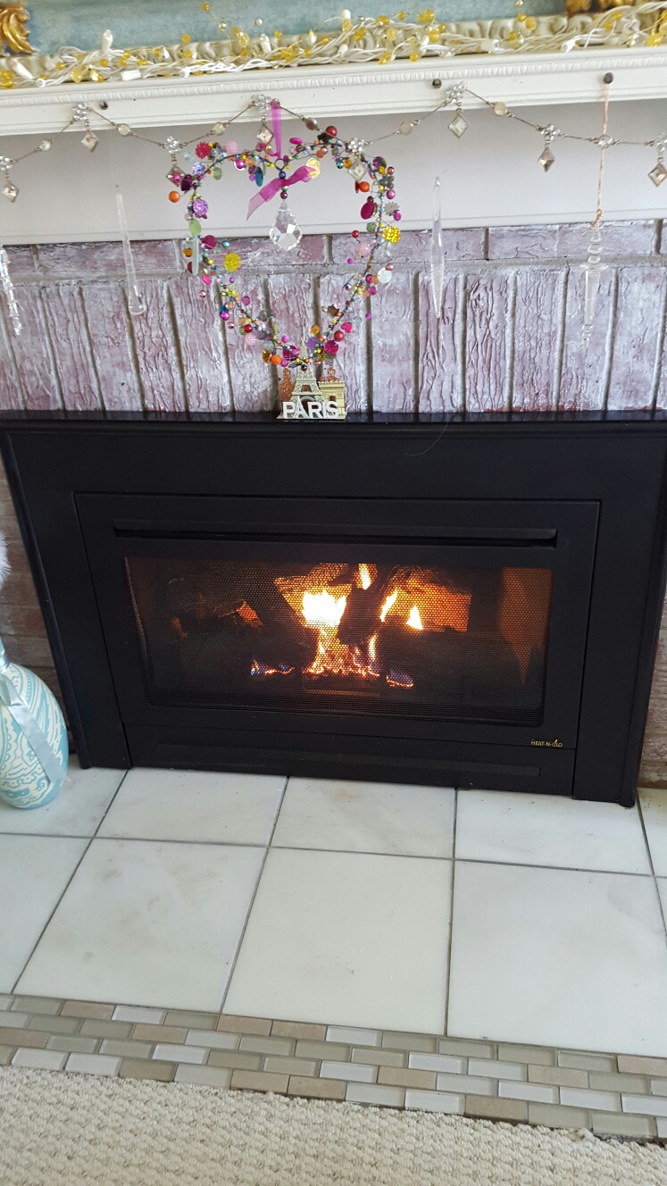 Berwyn Heights, MD - Heat N Glo gas fireplace insert & gas logs installation repair service call Berwyn Heights Maryland
