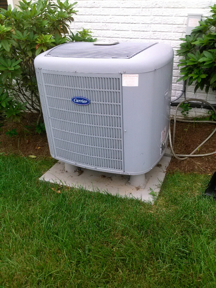 Gambrills, MD - Carrier heat pump AC air conditioner heating and air conditioning system installation repair service call in Gambrills Maryland.