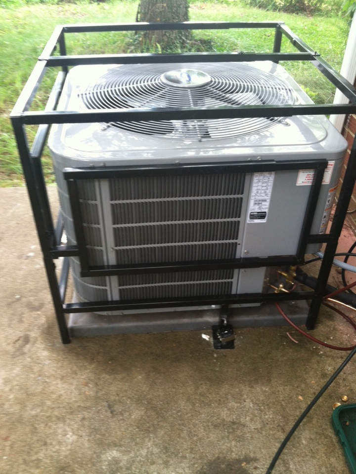 Goddard, MD - A/C air conditioner & air conditioning system coil replacement & theft protection cage installation service call in Goddard Maryland.