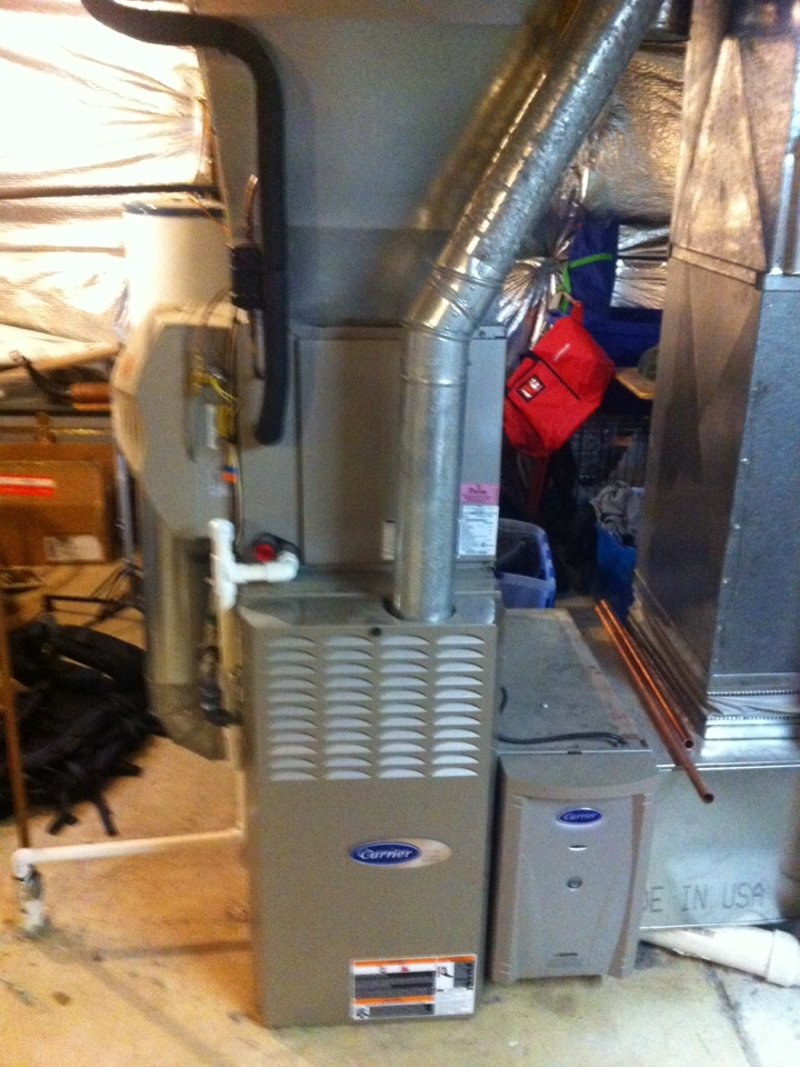 Crofton, MD - Carrier gas furnace AC heating and air conditioning system installation repair service call in Crofton Maryland.