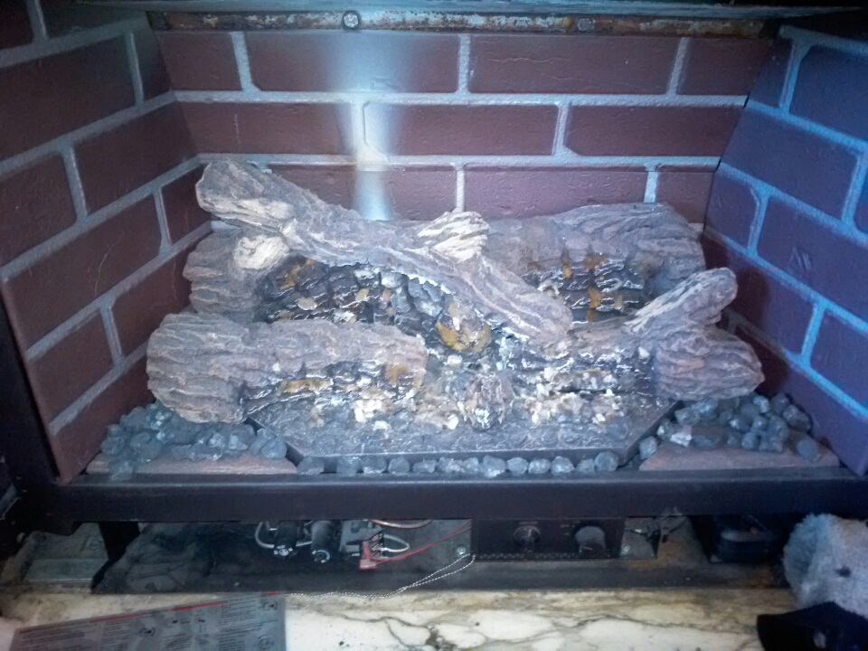 Crownsville, MD - Gas fireplace logs insert installation repair service call in Crownsville Maryland.