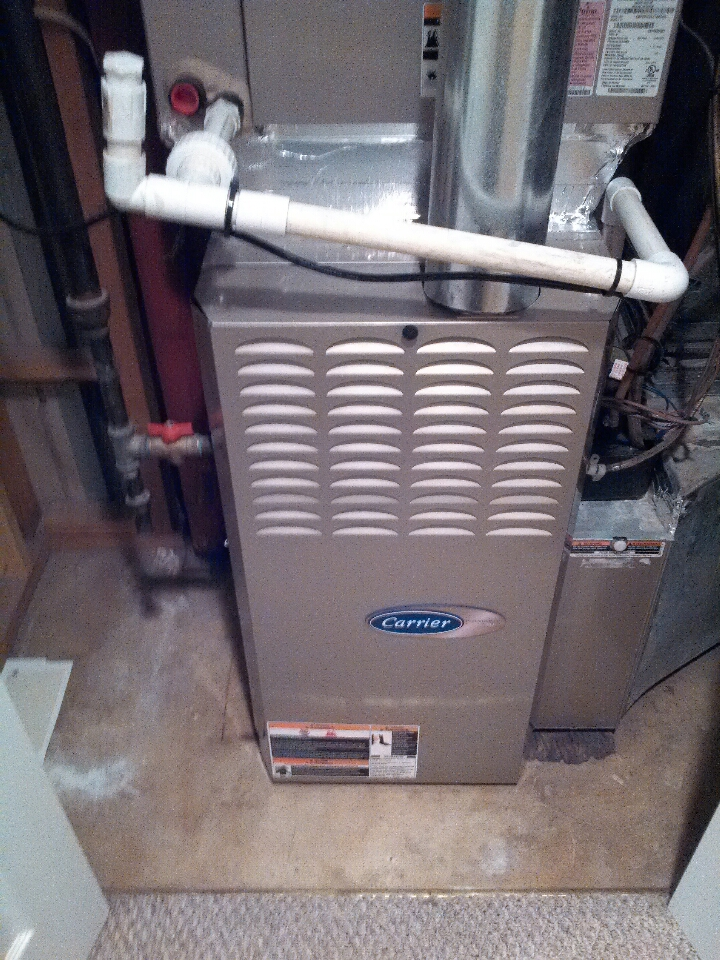 Crofton, MD - Carrier gas furnace ac heating & cooling system installation repair service call in Crofton Maryland.