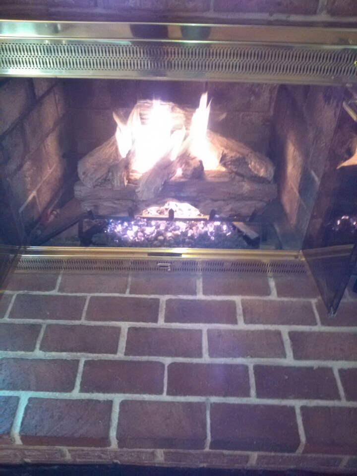 Crofton, MD - Gas fire place insert & gas logs installation repair service call in Crofton Maryland.