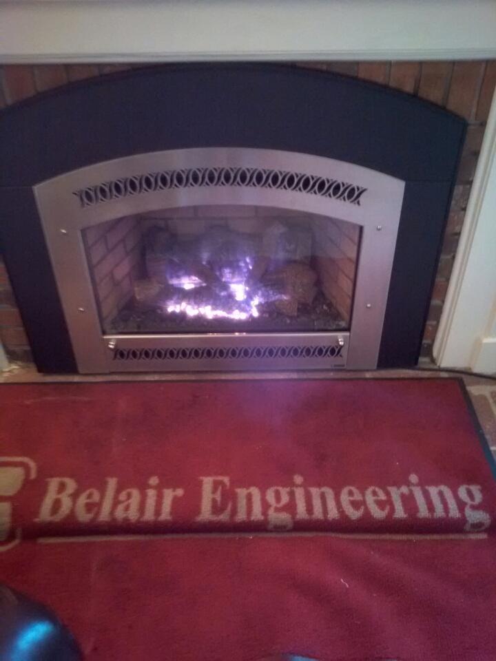 Crofton, MD - Gas fireplace insert & gas logs installation repair service maintenance call in Crofton Maryland.