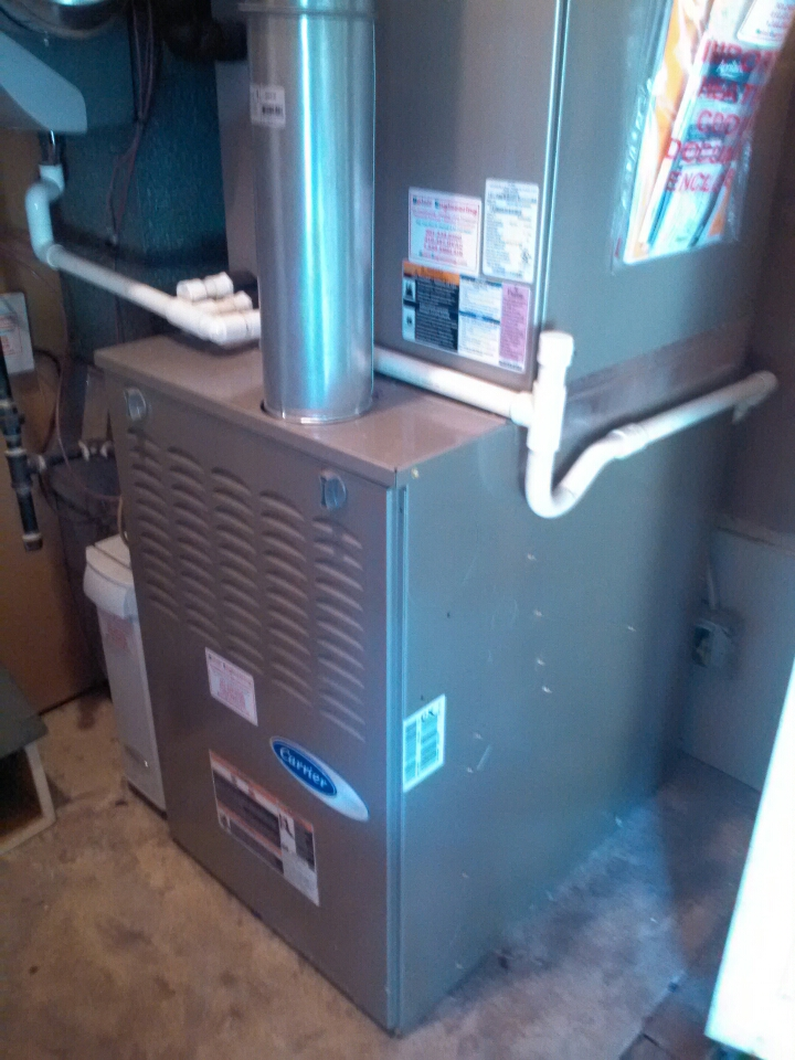 Crofton, MD - Carrier gas furnace heating and air conditioning system installation repair service call in Crofton Maryland.