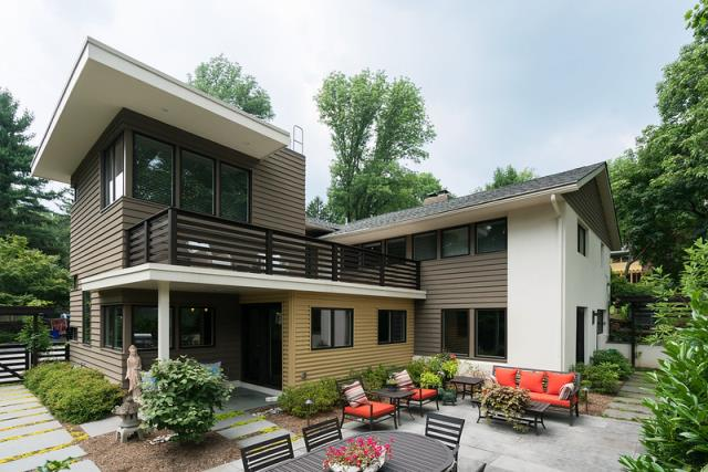Saint Davids, PA - Contemporary 2 story addition and whole house remodel transformed this formerly modest 1950s two-story home. The new master suite has a private deck and marble bath. The new kitchen features Omega cabinets with a double waterfall island and stainless steel appliances. New maple hardwood flooring is run throughout the first floor. The exterior finishes include James Hardie cement siding with tightly mitered corners, fiberglass roofing and deck surfaces, Pella windows, and custom corrugated metal siding for a unique contrast. One might think this home rested on a cliff in Malibu rather than in a cul-de-sac in Wayne, PA.