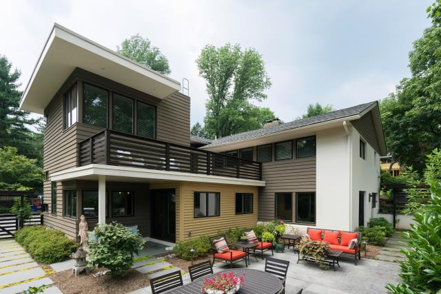 Saint Davids, PA - This two story ultra-contemporary addition and whole house remodel to a formerly understated Wayne home on Brookside Circle received a new kitchen and master suite. Both were added with fiberglass roof decks and a combination of Hardi siding and corrugated metal. The expansive views to the beautiful new patio area sets the mood for relaxation and entertaining!