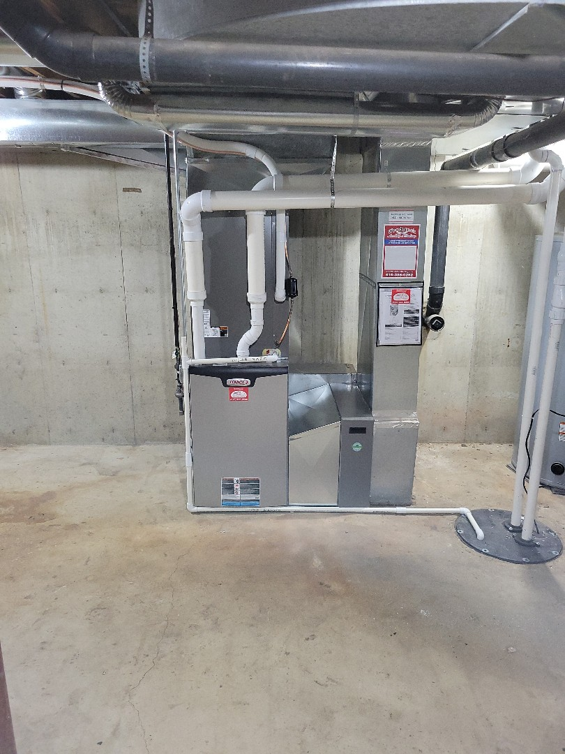 Woodstock, IL - High efficiency Lennox furnace install done by Whit. Customer also had a media cabinet installed to help with indoor air quality.