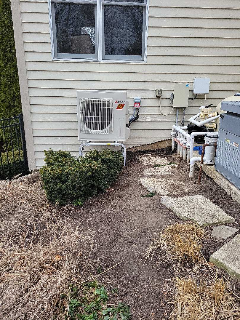 Crystal Lake, IL - Whit's install of the outdoor unit as part of the Mitsubishi Ductless Mini Split to heat and cool customer's garage. This was an ideal install because of the short distance from the indoor unit to the outdoor unit.
