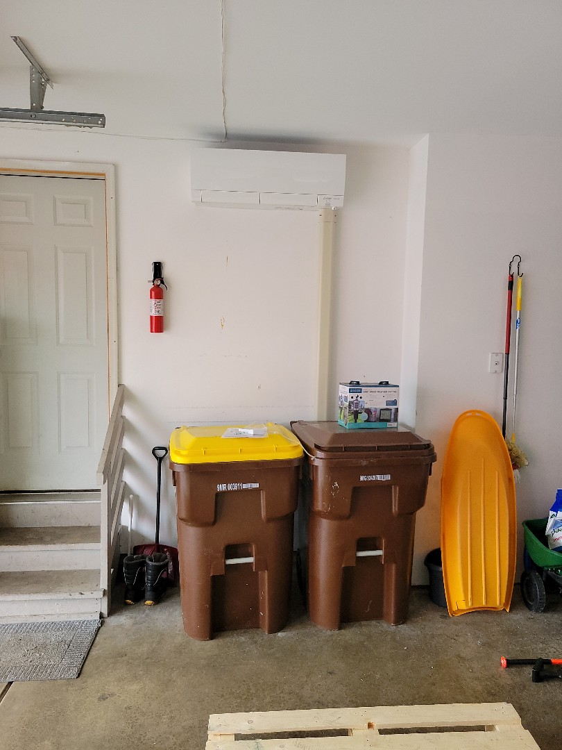 Crystal Lake, IL - Whit's install of the Mitsubishi Ductless Mini Split Indoor Unit. The line hide makes the line set look much nicer. The line set connects to the outdoor unit.