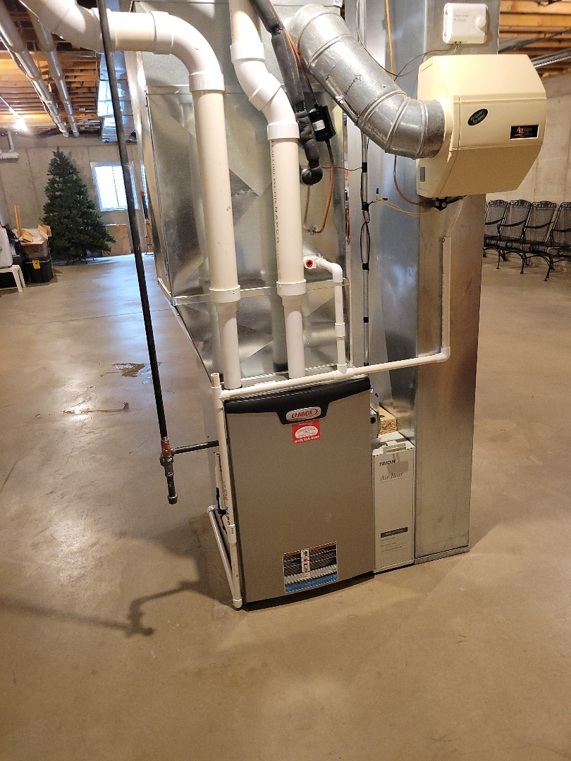 McHenry, IL - New high-efficiency furnace install performed by Whit. The new heater installation included a new condensate run from the humidifier.