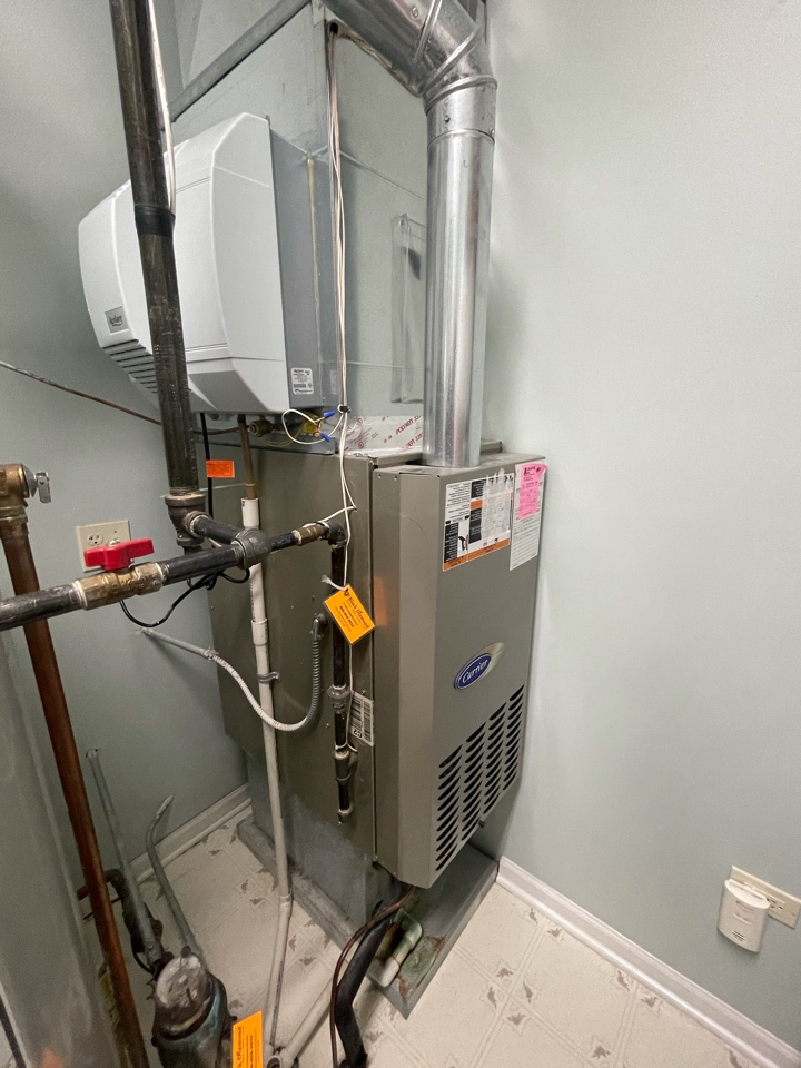 Huntley, IL - Customer was being proactive for warm weather, wanting an estimate for her AC and heater. She was given a free estimate for a downflow furnace and air conditioner.
