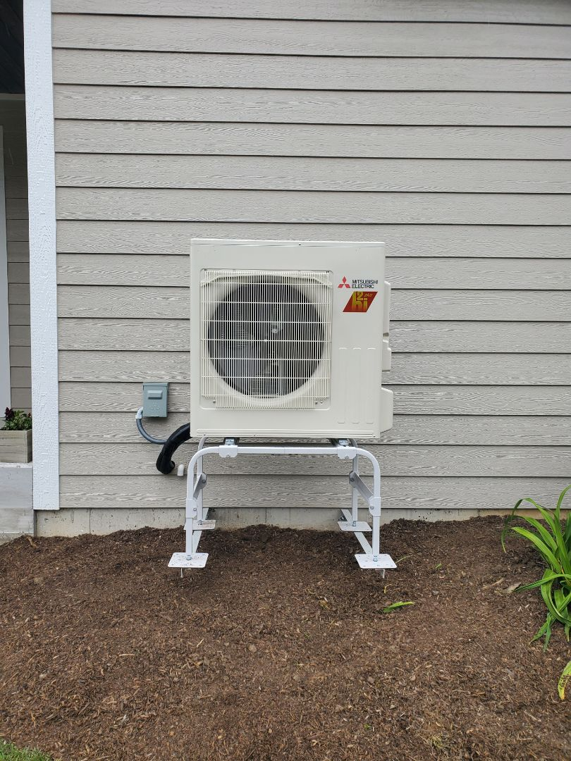 Cary, IL - A Mitsubishi ductless mini split install for zoning performed by Whit and Alex. This is the outdoor unit, part of a multi zone system.