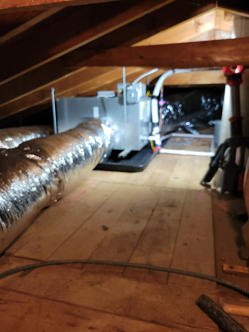 Crystal Lake, IL - Customer had no existing ductwork with radiant heating (boiler). To get them AC we installed a new Unico high velocity system.