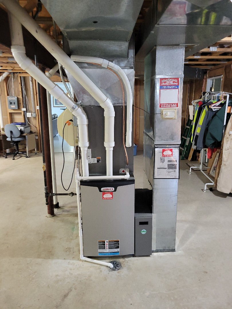 Marengo, IL - Whit's install of a new full system, furnace, air conditioner, and a new media cabinet for their new more efficient filter. Due to the age of the previous equipment, this client decided to replace rather than repair.