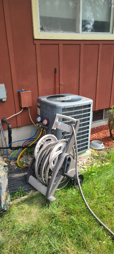 Harvard, IL - Repairing an air conditioner in a pre-built house that has an air handler in the hallway ceiling.